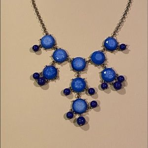 Used blue costume necklace with gold accent